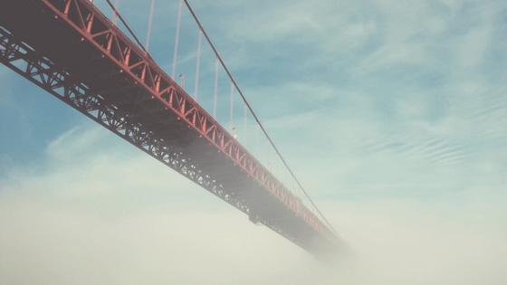 The Golden Gate bridge disappearing into the clouds.
