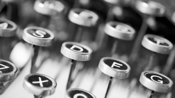 black and white close up typewriter keys