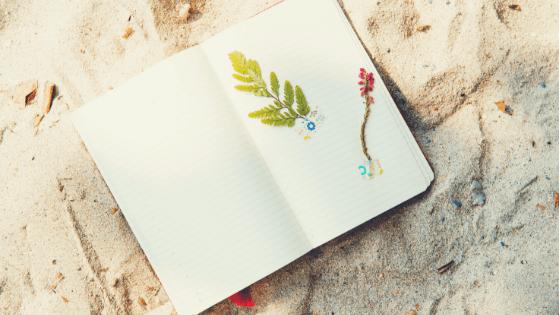 A notebook on a beach.