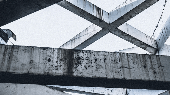 white and rusted concrete beams