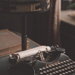 smith corona typewriter beside vintage lamp