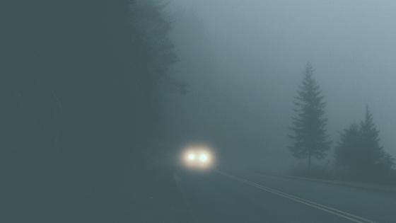 car headlights in fog