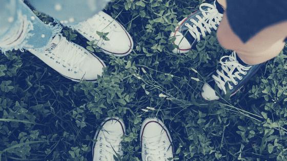 three women wearing converse sneakers