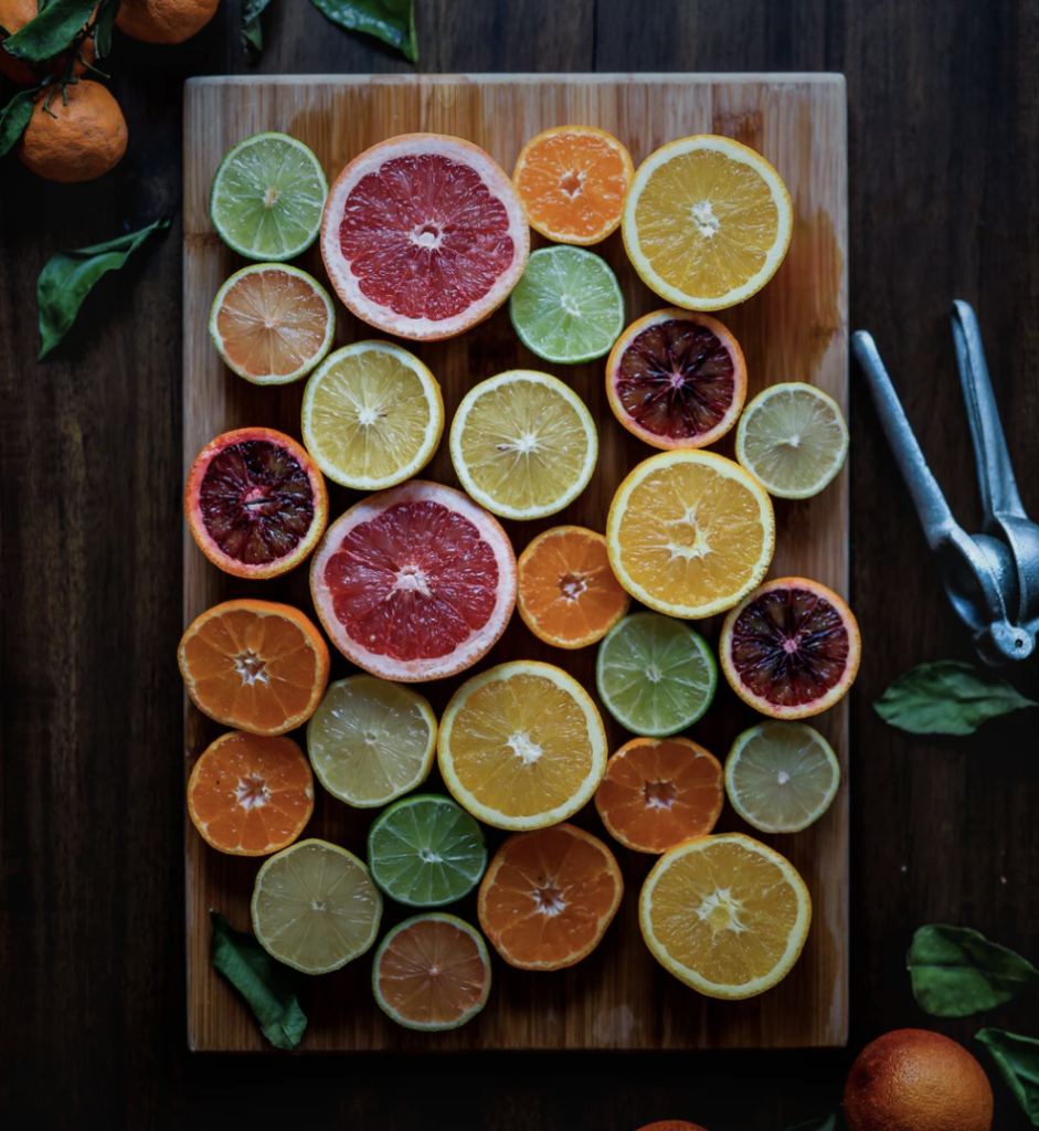 sliced citrus fruits on cutting board